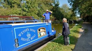 A chaplain on the towpath speaking with a boater