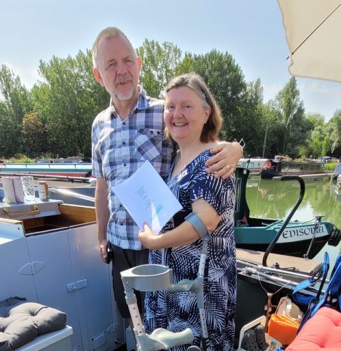 """A blessing for a couple and their new boat """"Dignity"""" on the Grand Union canal"""